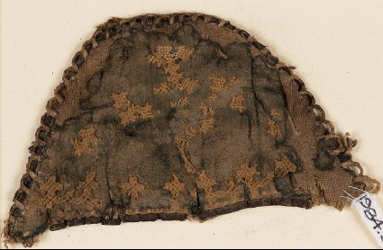Textile fragment from a slipper front with linked crossesfront