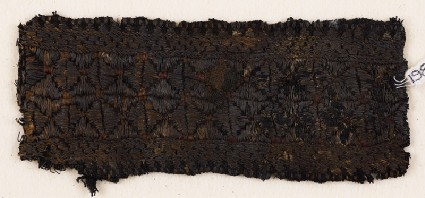 Textile fragment with band of stars or flowersfront