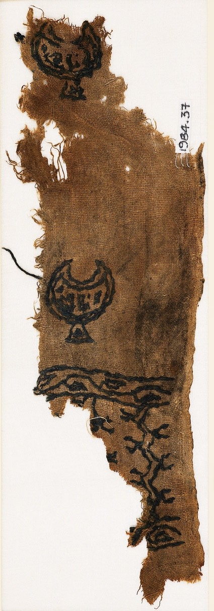 Textile fragment with crescents or cups, chevrons, and vinefront