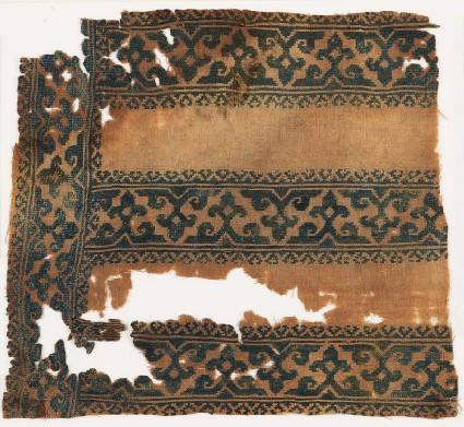 Textile fragment with tendrils, trefoils, and foliate bordersfront