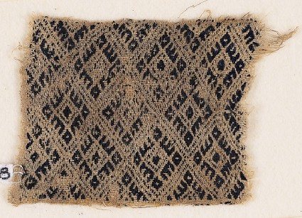 Textile fragment with linked diamond-shapesfront