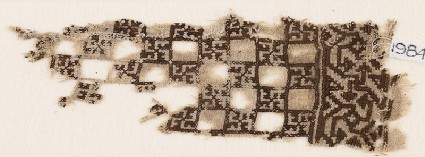Textile fragment with linked squares and swastikasfront