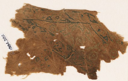 Textile fragment with vines and leaves, probably from a garment or trousersfront