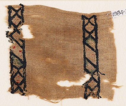 Textile fragment with rhombuses and diamond-shapesfront
