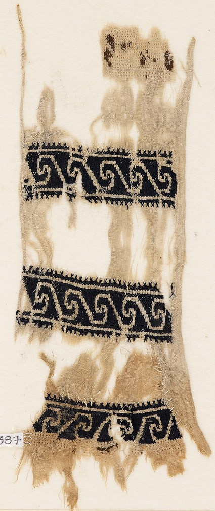 Textile fragment with scrollsfront