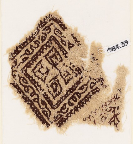 Textile fragment with square, vine, and quatrefoilfront