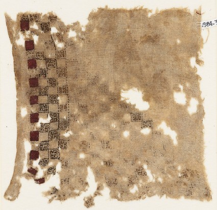 Textile fragment with swastika-filled squaresfront