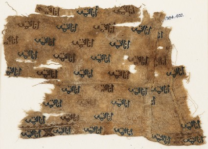 Textile fragment with repeated inscriptionfront