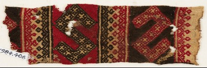 Textile fragment with two large S-shapesfront