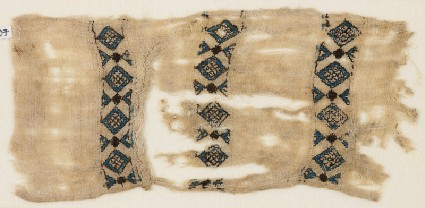 Textile fragment with three bands of diamond-shapesfront