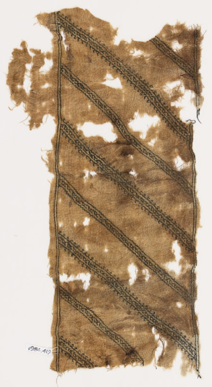 Textile fragment with stripes of vines and leavesfront