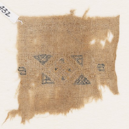 Textile fragment with band framed by trianglesfront