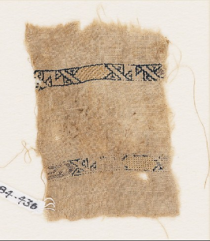 Textile fragment with two bands with cartouches and diagonal linesfront