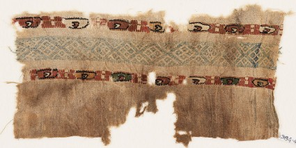 Textile fragment with two bands of ovals containing small crescentsfront