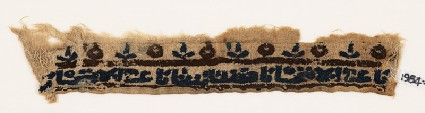 Textile fragment with inscription, possibly from a cufffront