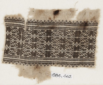 Textile fragment with vines, leaves, and flower-headsfront