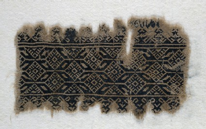 Textile fragment with interlocking hexagons and diamond-shapesfront