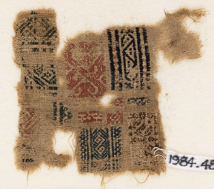 Sampler fragment with bands of S-shapes and trianglesfront