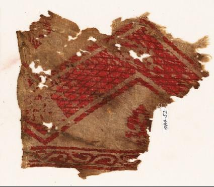 Textile fragment with chevron, fleur-de-lys, and vinefront