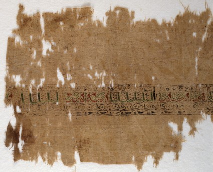 Textile fragment with band of pseudo-inscription, leaves, and vinesfront