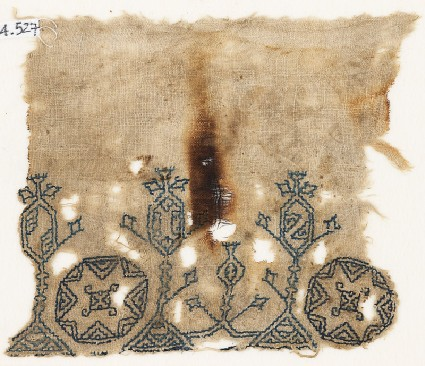 Textile fragment with three stylized treesfront