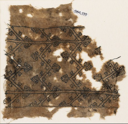 Textile fragment with chevrons and tendrilsfront