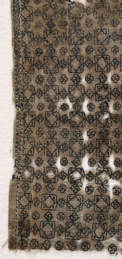 Textile fragment with squares and interlacing knotsfront