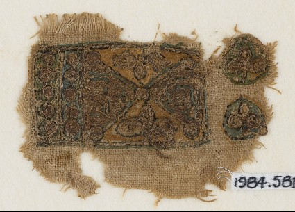 Textile fragment with two trefoils and rows of circlesfront