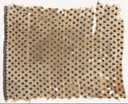 Textile fragment with diamond-shapes and a border of heart-shaped flowersfront