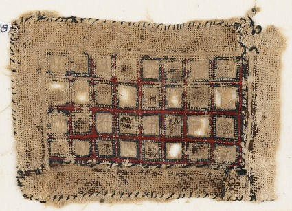 Textile fragment with rectangle containing squaresfront