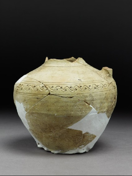 Fragmentary jar with incised decorationside