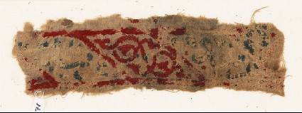 Textile fragment with lozenges, arabesque, and inscriptionfront