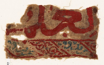 Textile fragment with remains of inscriptionfront