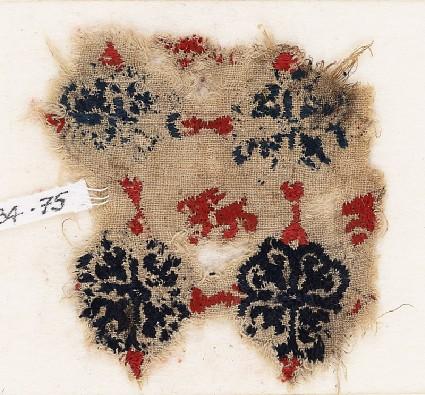 Textile fragment with lion and grid of quatrefoil flowersfront