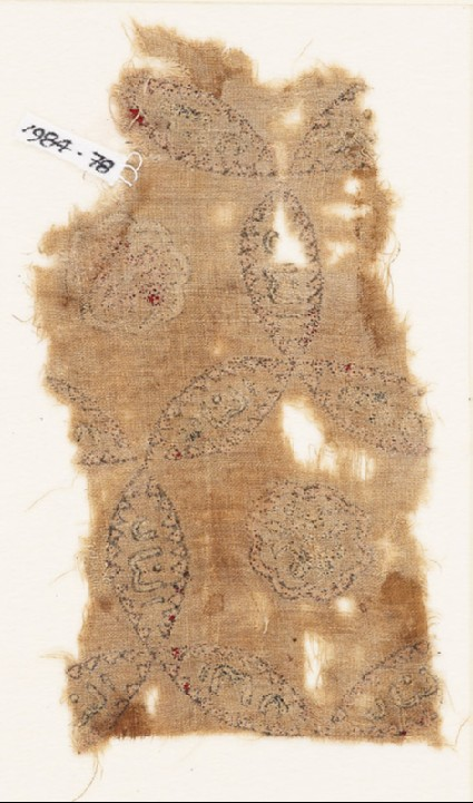 Textile fragment with linked circles, inscription, and possibly a lionfront