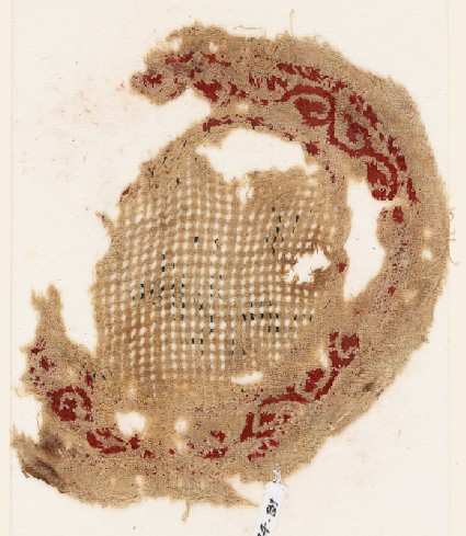 Roundel textile fragment with vine borderfront