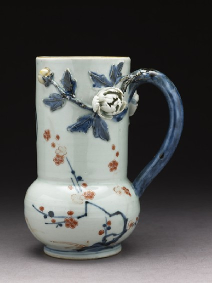 Tankard with modelled flowers and leavesside