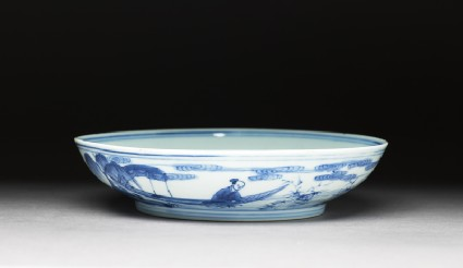 Blue-and-white dish with figures in a landscapeoblique