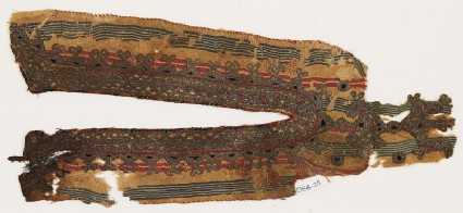 Textile fragment from the neck opening of a garmentfront