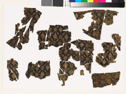 Textile fragment with medallions and starsfront