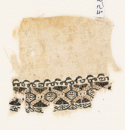 Textile fragment with pseudo-inscription borderfront