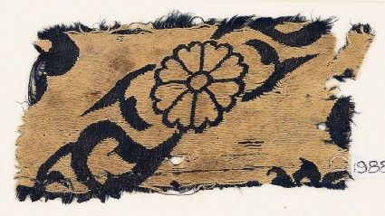 Textile fragment with flowers and leavesfront