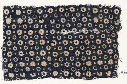 Textile fragment with rings, stars, and dotsfront