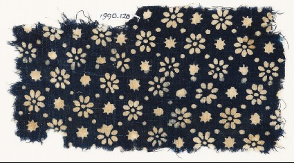 Textile fragment with rosettes, stars, and dotsfront