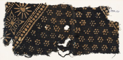Textile fragment with rosettes and band with floral shapesfront