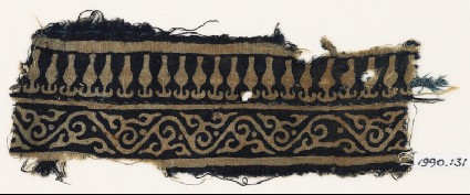 Textile fragment with vine and stylized bodhi leavesfront