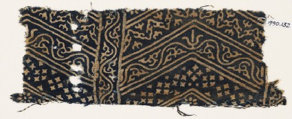 Textile fragment with linked chevrons, vine, and starsfront