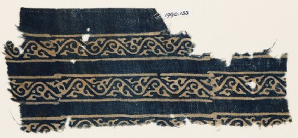 Textile fragment with bands of vines and leavesfront