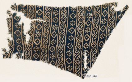Textile fragment with vines, rosettes, and diamond-shapesfront