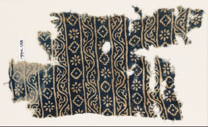 Textile fragment with bands of vines, rosettes, and diamond-shapesfront